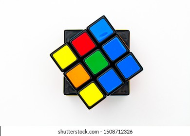Saint-Petersburg, Russia - JULY 17, 2019 : Rubik's cube, rubik's cube top view isolated, rubik's cube on white background, colorful puzzle, math problem, charging for your brain, cube rainbow palette