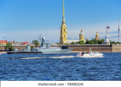 SAINT-PETERSBURG, RUSSIA - JULY 23, 2017: The boat of the commander-in-chief of the Navy makes a detour around the front line of ships on rehearsal naval parade on the day of the Russian Fleet