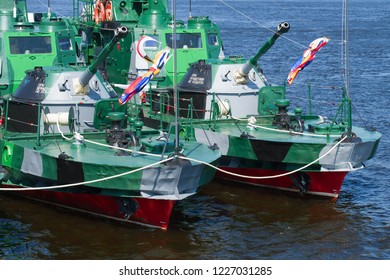 SAINT-PETERSBURG, RUSSIA - JULY 29, 2018: Nose-guns of two artillery boats of the project 1204 close-up. Navy Day in St. Petersburg