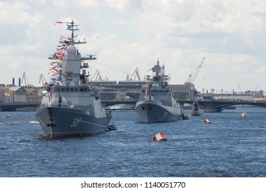 SAINT-PETERSBURG, RUSSIA - JULY 30, 2017: Ships of the Russian Navy in a wake column in the water area of the Neva. Navy Day in St. Petersburg