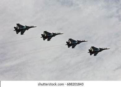 SAINT-PETERSBURG, RUSSIA - JULY 30, 2017: Warships parade on the Neva river. Day of the Russian Navy. Combat aircraft in sky