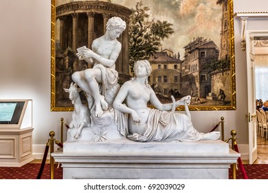 "SAINT-PETERSBURG, RUSSIA - JULY 4, 2017: Sculpture ""Nymph and shepherd"" in the Anteroom of the Kamennoostrovsky Palace on Kamenny Island in St. Petersburg, where now houses the Academy of Talents"