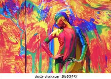 SAINT-PETERSBURG, RUSSIA - JUNE 10, 2015: A woman (street actress) painted by colorful paints poses for photos on Dvortsovaya Square in Saint-Petersburg, Russia.