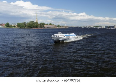 SAINT-PETERSBURG, RUSSIA, June 19, 2017, High-speed pleasure boat on underwater wings floats on the river Neva in a historical central Saint Petersburg on a sunny day
