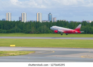 """SAINT-PETERSBURG, RUSSIA - JUNE 20, 2018: Airbus A319-112 """"Yaroslavl"""" (EI-EZD) off Rossiya airline takes off on the Pulkovo airport on a sunny summer day"""