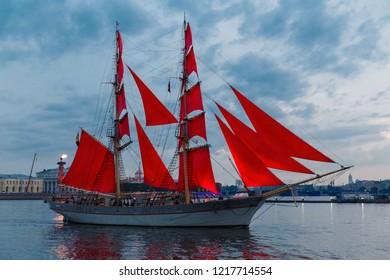 "SAINT-PETERSBURG, RUSSIA - JUNE 21, 2018: Swedish brig Tre Krunur on rehearsal for the annual celebration school graduates ""Scarlet Sails"" in St. Petersburg on the evening Neva"