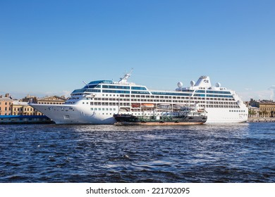 SAINT-PETERSBURG, RUSSIA JUNE 28, 2014: Cruise liner Ocean Princess and the tank vessel Gazpromneft Northwest at the English embankment, St.-Petersburg