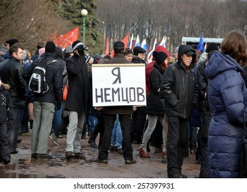 SAINT-PETERSBURG, RUSSIA, MARCH 1, 2015 - Procession in memory of Boris Nemtsov in St. Petersburg on March 1st 2015. A man with a poster: I am Nemtsov