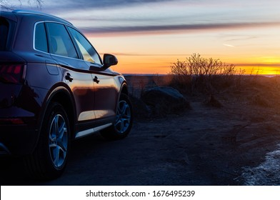 Saint-Petersburg, Russia - March 15th, 2020: Audi Q5 at sunset with beautyful reflection on its side.