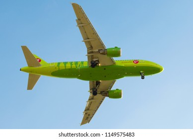 """SAINT-PETERSBURG, RUSSIA - MAY 08, 2018: Airbus A319-114 (VP-BHL) of the airline """"S7 - Siberia Airlines"""" calls for landing. Bottom view"""