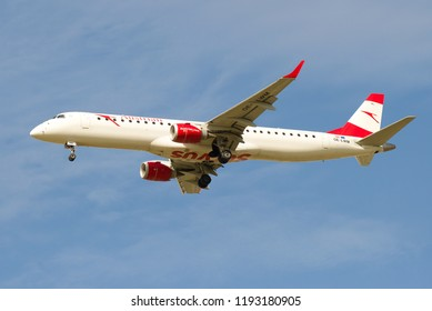 SAINT-PETERSBURG, RUSSIA - MAY 08, 2018: Embraer ERJ-195LR (OE-LWM) Austrian Airlines airplane close up in blue sky