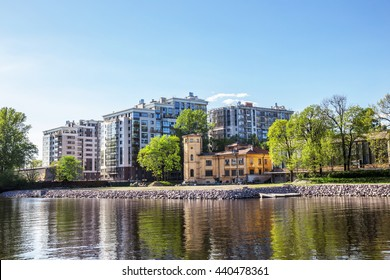 SAINT-PETERSBURG, RUSSIA - MAY 12, 2016: Old building of Alsufev Dacha on the banks of the Nevka River against of a new residential complex Life-Primorskiy