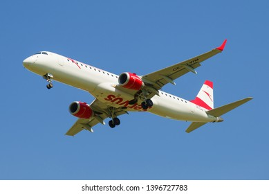 SAINT-PETERSBURG, RUSSIA - MAY 13, 2019: Embraer ERJ-195LR (OE-LWM) Austrian Airlines airplane on a glide path close-up