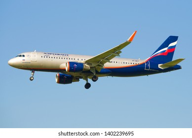 "SAINT-PETERSBURG, RUSSIA - MAY 13, 2019: Airbus A320-200 ""A. Voznesensky"" (VP-BET) aircraft of Aeroflot airlines before landing at Pulkovo airport. Side view"