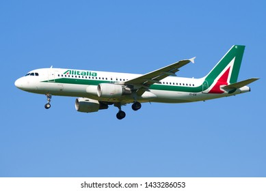SAINT-PETERSBURG, RUSSIA - MAY 13, 2019: Airbus A320 (EI-EIE) aircraft of Alitalia Airlines close-up against a blue sky