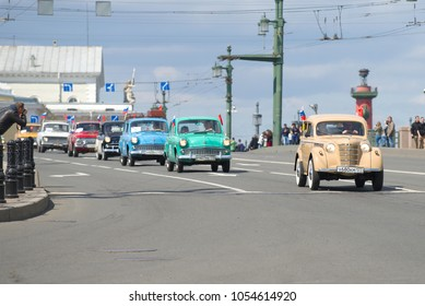 "SAINT-PETERSBURG, RUSSIA - MAY 21, 2017: Column of Soviet cars ""Moskvich"" of various models on the Palace Bridge. The third annual retro transport parade in St. Petersburg"