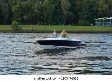 SAINT-PETERSBURG, RUSSIA - MAY 23, 2018: Speedboat or  motorboat driving on a water on a sunny summer evening  on MAY 23, 2018 in Saint-Petersburg, Russia.