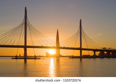 """SAINT-PETERSBURG, RUSSIA - MAY 28, 2018: Cable-stayed bridge of Western high-speed diameter and high-rise building """"Lakhta Center"""" on sunset background"""