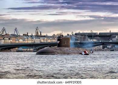 SAINT-PETERSBURG, RUSSIA - MAY 3, 2017: The diesel submarine Kolpino with crew on a deck on the roads in the middle of the Neva river opposite English embankment