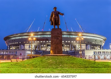 "SAINT-PETERSBURG, RUSSIA - MAY 30, 2017: Night view of monument to prominent figure of the Bolshevik Party Kirov before new soccer ""Saint-Petersburg Arena"" in St. Petersburg for the World Cup 2018"