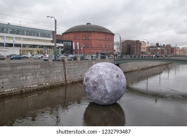 SAINT-PETERSBURG, RUSSIA – NOVEMBER 10, 2018: Full Moon Installation in The Obvodny Canal on The Festival of Light. On the background is The Planetarium № 1in former gas holder building
