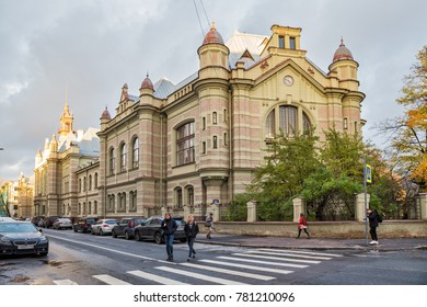 SAINT-PETERSBURG, RUSSIA - OCTOBER 18, 2017: First oldest building St. Petersburg Electrotechnical University LETI on street of Professor Popov. People on street in background of historic building