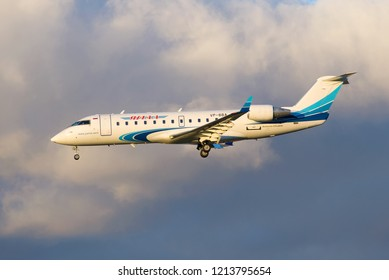 SAINT-PETERSBURG, RUSSIA - OCTOBER 25, 2018: Bombardier CRJ-200 (VP-BBA) aircraft of Yamal Airlines in a cloudy sky