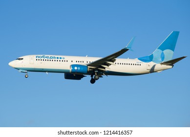 SAINT-PETERSBURG, RUSSIA - OCTOBER 25, 2018: Boeing 737-800 (VQ-BTJ) of the Pobeda Airlines close-up against a cloudless blue sky