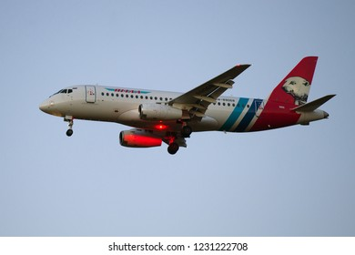 SAINT-PETERSBURG, RUSSIA - OCTOBER 25, 2018: Airplane Sukhoi Superjet 100 (RA-89087) Yamal Airlines in the evening twilight before landing on Pulkovo airport