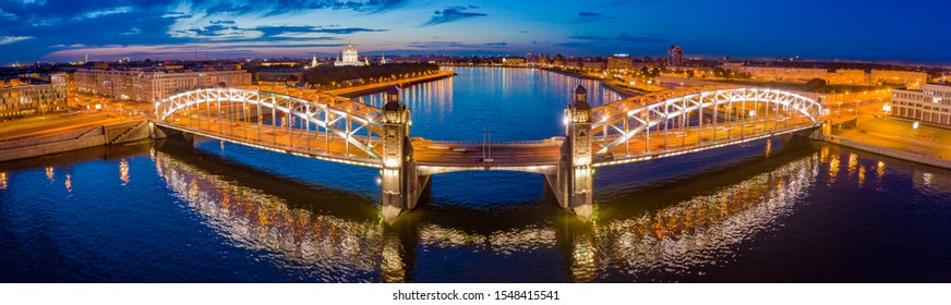 Saint-Petersburg. Russia. Panorama Bolsheokhtinsky bridge. Peter the Great bridge in the evening. Bridges Of St. Petersburg. Rivers Of St. Petersburg. Neva River. Reflections in the river.