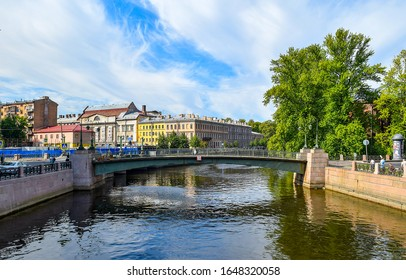SAINT-PETERSBURG, RUSSIA - Red Navy bridge over Moika river in Saint Petersburg, Russia