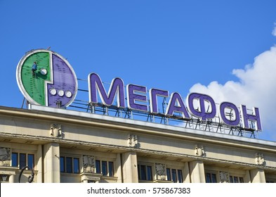 SAINT-PETERSBURG, RUSSIA, SEPT 22, 2013 - Workers fix Megafon logo on the facade of the building. MegaFon previously known as North-West GSM is the second largest mobile operator in Russia