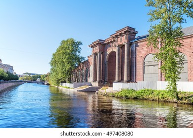 SAINT-PETERSBURG, RUSSIA - SEPTEMBER 13, 2016: Ancient arch over the canal on the island of New Holland from the side of the Moika river in Saint Petersburg
