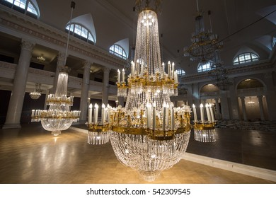 Saint-Petersburg, Russia - September 6, 2016: Huge crystal chandeliers in the large concert hall of the State Philharmonic Tchaikovsky lowered to the floor to remove dust