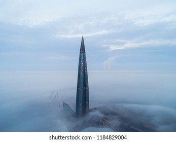 Saint-Petersburg, Russia, September 6 2018: Aerial view of multipurpose center Lahta, the central office, headquarters of group of companies Gazprom at sunrise on  Gulf of Finland. City in fog. Lakhta
