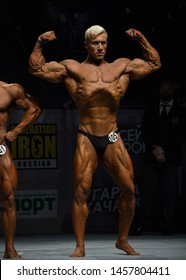 Saint-Petersburg, Russian Federation-September 21, 2018 : Bodybuilder shows his physique with a front double biceps at Open Cup of bodybuilding and fitness of Saint-Petersburg