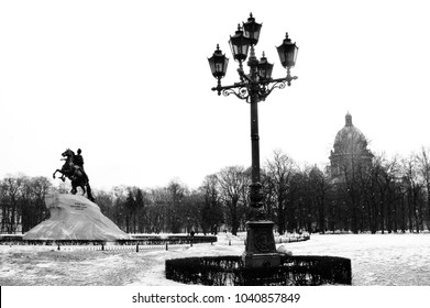 Saint-Petersburg in winter, at snowfall. Monument to Peter the Great and Saint Isaak Catheral.