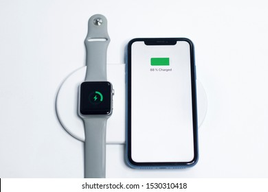 Saint-Petersburg/Russia - 09.09.2019: Apple new gadgets, devices charging on wireless charge together. New fast charger, modern technology concept. Smartphone iPhone, smartwatch Apple watch. AirPower