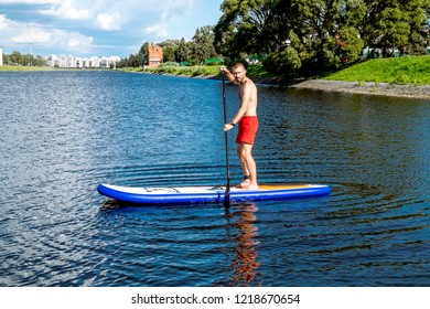 Saint-Petersburg.Russia.August 4, 2018.A man riding a sup  paddle board on the water Rowing canal in St. Petersburg