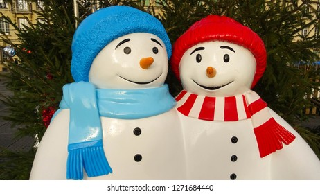 Saint-Quentin / France: 12 24 2018: snowman couple with winter hats and scarfs, part of Christmas decoration in the city of Saint-Quentin, Picardy, northern France, Europe