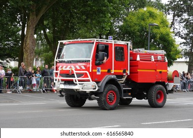 SAINT-QUENTIN, FRANCE-JULY 14, 2015: French fire truck parading for the national day of 14 July commemorating the French Revolution. Saint Quentin in Picardie region of France