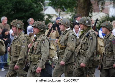 SAINT-QUENTIN, FRANCE-JULY 14, 2015: Parade of people disguised as US soldiers of the Second World War for the national holiday of 14 July in Saint Quentin. Picardie region de France