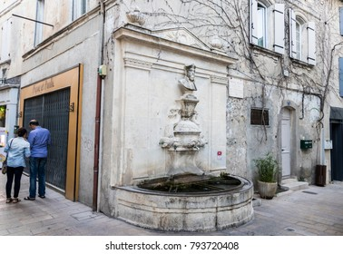 SAINT-REMY-DE-PROVENCE, FRANCE - August 11, 2017: Water fountain with a bust of Michel de Nostradame or Nostradamus in the Old Town of his hometown and birthplace