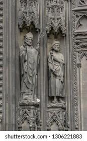 Saints Statues at central portal of western facade of Saint-Ouen-de-Rouen. Rouen Saint-Ouen Abbey Church (Abbatiale Saint-Ouen, 1318 - 1537) - Gothic Roman Catholic church in Rouen, Normandy, France.