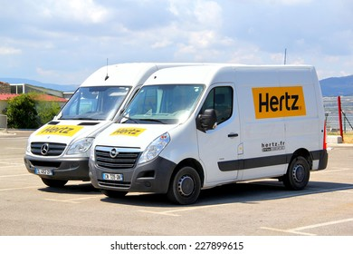 SAINT-TROPEZ, FRANCE - AUGUST 3, 2014: White cargo vans Opel Movano and Mercedes-Benz Sprinter at the city parking.