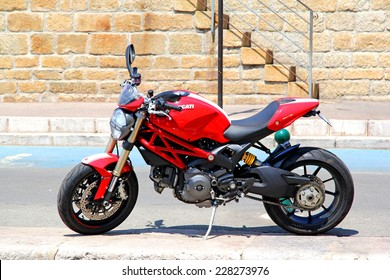SAINT-TROPEZ, FRANCE - AUGUST 3, 2014: Red motorcycle Ducati Monster at the city street.