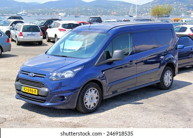 SAINT-TROPEZ, FRANCE - AUGUST 3, 2014: Blue cargo van Ford Transit Connect at the city street.