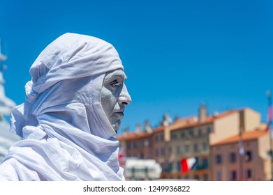 SAINT-TROPEZ, FRANCE - JUNE 06, 2013: Mime artist on the promande in Saint-Tropez in the Department Var of the province Provence-Alpes-Cote d Azur