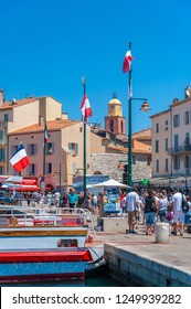 SAINT-TROPEZ, FRANCE - JUNE 06, 2013: Tourists on the promenade Quai Gabriel Peri in Saint-Tropez in the Department Var of the province Provence-Alpes-Cote d Azur