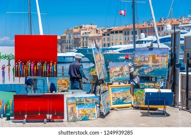 SAINT-TROPEZ, FRANCE - JUNE 06, 2013: Paintings at the promenade Quai Gabriel Peri in Saint-Tropez in the Department Var of the province Provence-Alpes-Cote d Azur